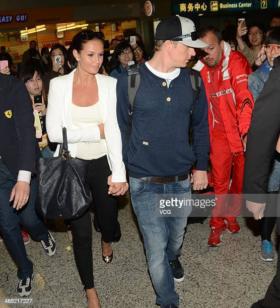 Kimi Raikkonen of Finland and Ferrari and his girlfriend Minttu Virtanen arrive at Pudong Airport on April 17 2014 in Shanghai China