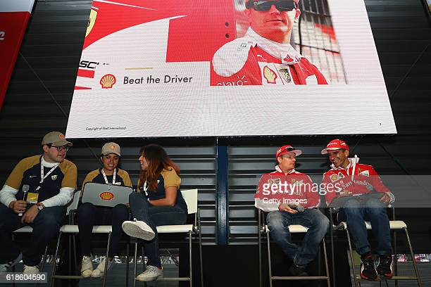 Kimi Raikkonen of Finland and Ferrari and Marc Gene of Spain on stage at the Shell Eco Marathon event during the Formula One Grand Prix of Mexico at...