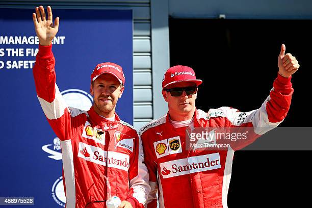 Kimi Raikkonen of Finland and Ferrari and Sebastian Vettel of Germany and Ferrari celebrate in Parc Ferme after claiming second and third...