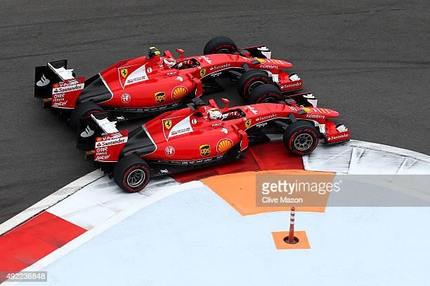 Kimi Raikkonen of Finland and Ferrari and Sebastian Vettel of Germany and Ferrari race during the Formula One Grand Prix of Russia at Sochi Autodrom...