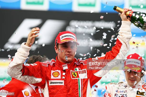 Kimi Raikkonen of Finland and Ferrari celebrates on the podium after winning the race and the F1 World Championship at the Brazilian Formula One...