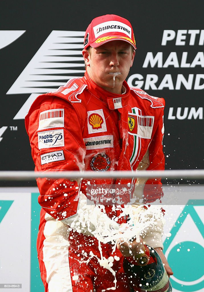 Kimi Raikkonen of Finland and Ferrari celebrates on the podium after winning the Malaysian Formula One Grand Prix at the Sepang Circuit on March 23, 2008 in Kuala Lumpur, Malaysia.