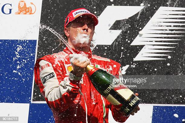 Kimi Raikkonen of Finland and Ferrari celebrates on the podium after winning the Belgian Grand Prix at the Circuit of Spa Francorchamps on August 30,...