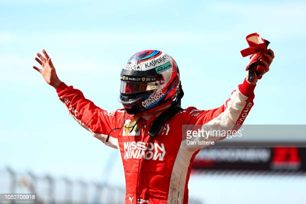 Kimi Raikkonen of Finland and Ferrari celebrates victory after the United States Formula One Grand Prix at Circuit of The Americas on October 21,...