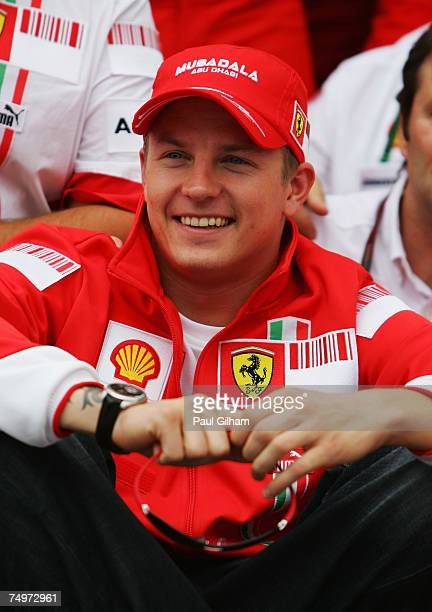 Kimi Raikkonen of Finland and Ferrari celebrates victory with Ferrari team mates after the French Formula One Grand Prix at the Circuit de Nevers...