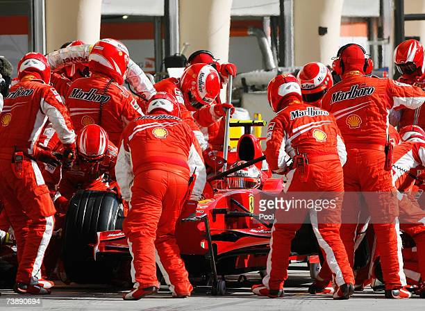 Kimi Raikkonen of Finland and Ferrari comes in for a pitstop during the Bahrain Formula One Grand Prix at the Bahrain International Circuit on April...