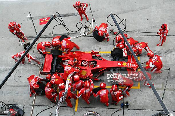 Kimi Raikkonen of Finland and Ferrari comes in for a pitstop during the Malaysian Formula One Grand Prix at the Sepang Circuit on March 23 2008 in...