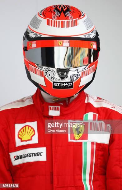 Kimi Raikkonen of Finland and Ferrari displays his drivers helmet during previews to the Australian Formula One Grand Prix at the Albert Park Circuit...