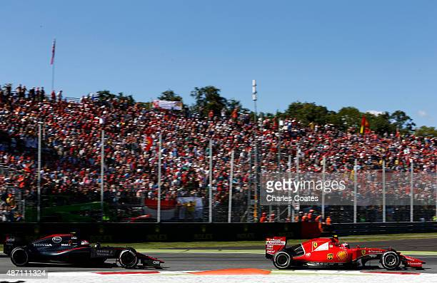 Kimi Raikkonen of Finland and Ferrari drives ahead of Jenson Button of Great Britain and McLaren Honda during the Formula One Grand Prix of Italy at...