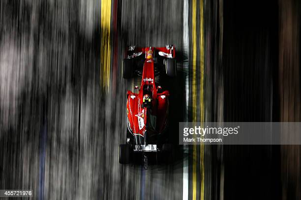 Kimi Raikkonen of Finland and Ferrari drives during practice ahead of the Singapore Formula One Grand Prix at Marina Bay Street Circuit on September...