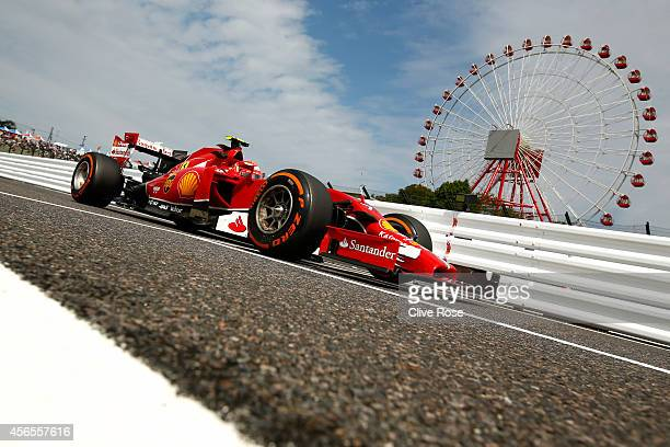 Kimi Raikkonen of Finland and Ferrari drives during practice for the Japanese Formula One Grand Prix at Suzuka Circuit on October 3 2014 in Suzuka...
