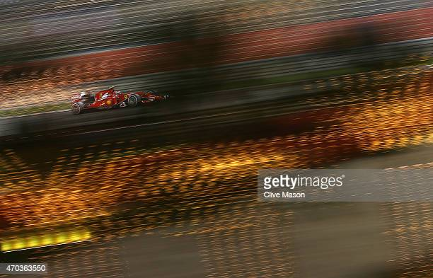 Kimi Raikkonen of Finland and Ferrari drives during the Bahrain Formula One Grand Prix at Bahrain International Circuit on April 19 2015 in Bahrain...