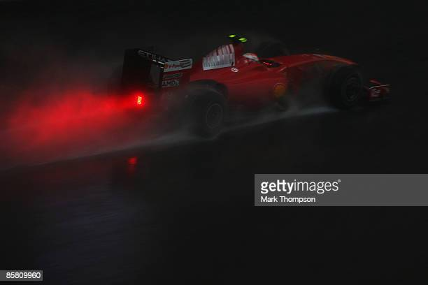 Kimi Raikkonen of Finland and Ferrari drives during the Malaysian Formula One Grand Prix at the Sepang Circuit on April 5 2009 in Kuala Lumpur...
