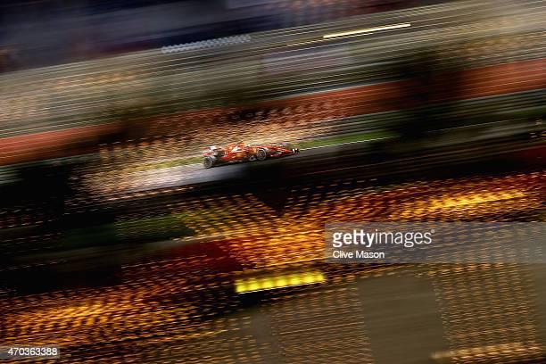 Kimi Raikkonen of Finland and Ferrari drives ing the Bahrain Formula One Grand Prix at Bahrain International Circuit on April 19 2015 in Bahrain...