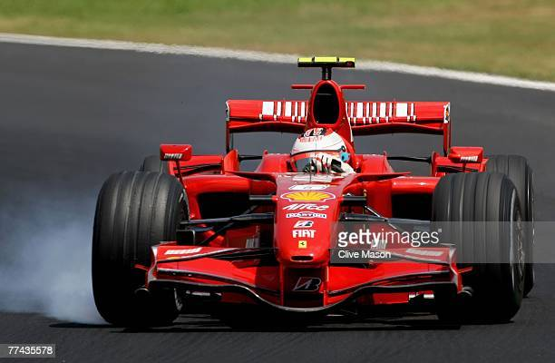 Kimi Raikkonen of Finland and Ferrari drives on his way to winning the race and the F1 World Championship at the Brazilian Formula One Grand Prix at...
