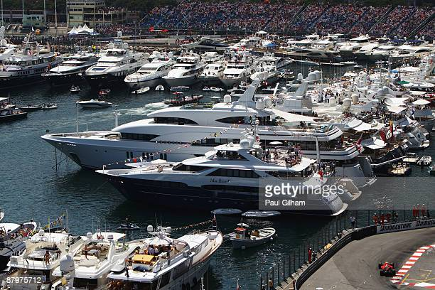 Kimi Raikkonen of Finland and Ferrari drives past the harbour during the Monaco Formula One Grand Prix at the Monte Carlo Circuit on May 24, 2009 in...