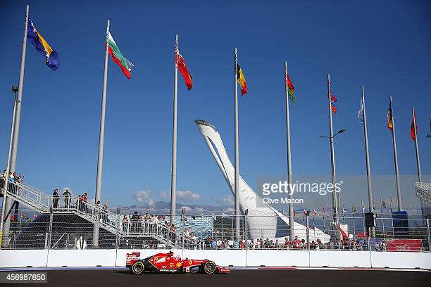 Kimi Raikkonen of Finland and Ferrari drives past the Olympic Cauldron during practice ahead of the Russian Formula One Grand Prix at Sochi Autodrom...