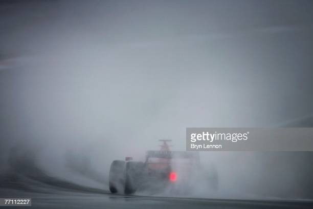 Kimi Raikkonen of Finland and Ferrari drives through the wet conditions on his way to finishing third during the Japanese Formula One Grand Prix at...