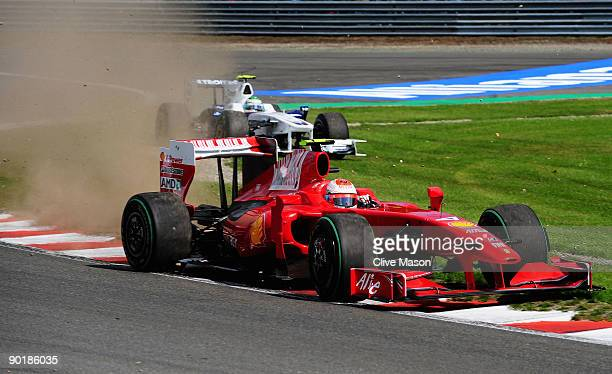 Kimi Raikkonen of Finland and Ferrari drives thru Les Combes corner on the first lap of the Belgian Grand Prix at the Circuit of Spa Francorchamps on...