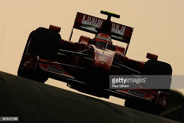 Kimi Raikkonen of Finland and Ferrari exits the pitlane at dusk during practice for the Abu Dhabi Formula One Grand Prix at the Yas Marina Circuit on...