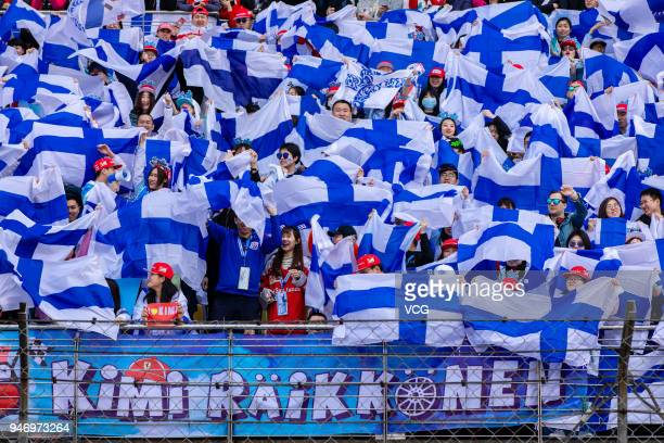 Kimi Raikkonen of Finland and Ferrari fans wave flags before the Formula One Grand Prix of China at Shanghai International Circuit on April 15 2018...