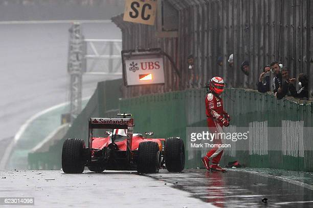 Kimi Raikkonen of Finland and Ferrari gets out of his car after crashing on the pit straight during the Formula One Grand Prix of Brazil at Autodromo...