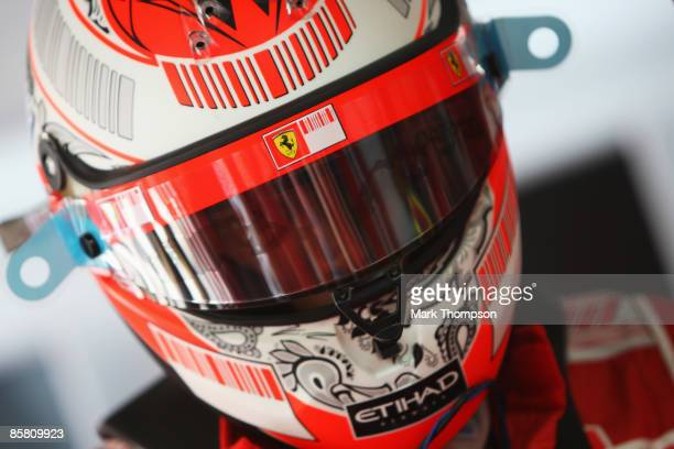 Kimi Raikkonen of Finland and Ferrari is seen in his team garage before the start of the Malaysian Formula One Grand Prix at the Sepang Circuit on...