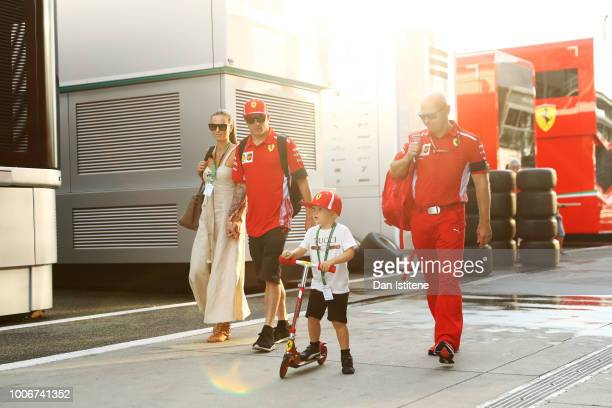 Kimi Raikkonen of Finland and Ferrari leaves the paddock with wife Minttu Virtanen and their son after qualifying for the Formula One Grand Prix of...