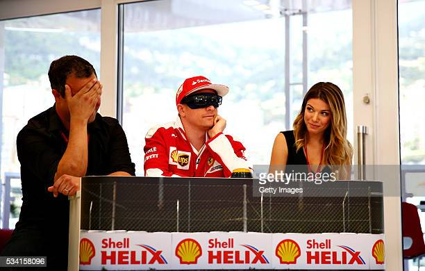 Kimi Raikkonen of Finland and Ferrari prepares for the mystery guest round with team mates Ted Kravitz Sky Sports F1 and Federica Masolin Sky F1...