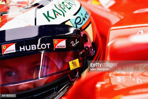 Kimi Raikkonen of Finland and Ferrari prepares to drive during qualifying for the Formula One Grand Prix of Italy at Autodromo di Monza on September...