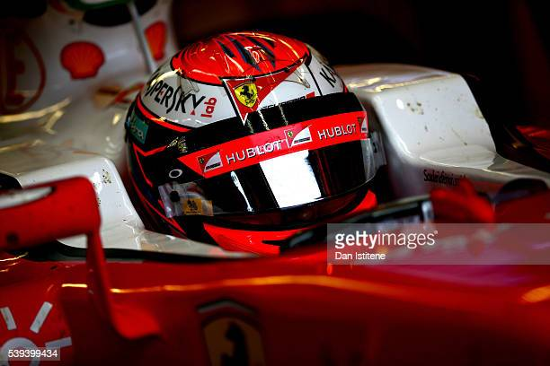 Kimi Raikkonen of Finland and Ferrari sits in his car in the garage during final practice ahead of the Canadian Formula One Grand Prix at Circuit...