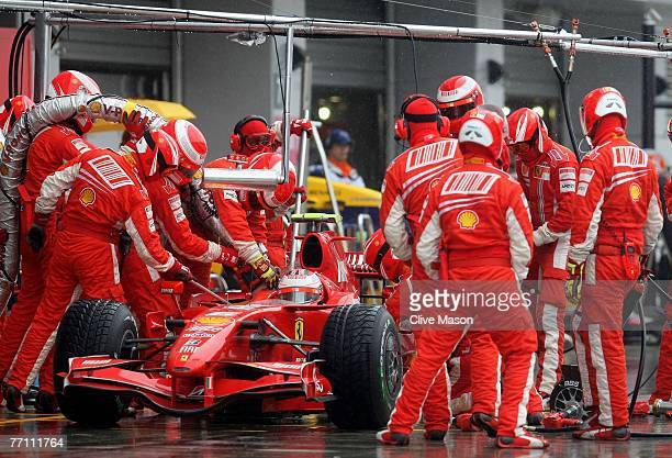 Kimi Raikkonen of Finland and Ferrari stops for a pitstop during the Japanese Formula One Grand Prix at the Fuji Speedway on September 30 2007 in...