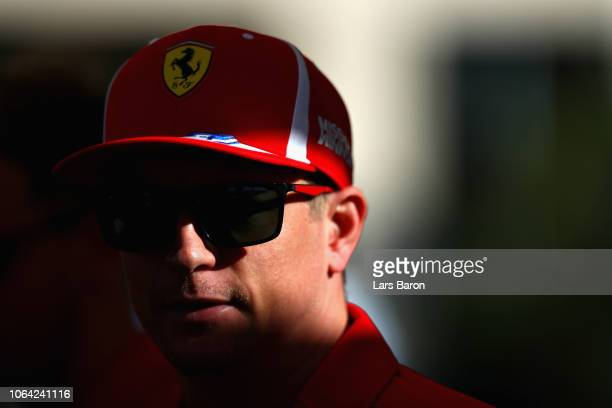 Kimi Raikkonen of Finland and Ferrari talks to the media in the Paddock during previews ahead of the Abu Dhabi Formula One Grand Prix at Yas Marina...