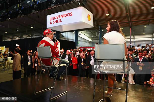 Kimi Raikkonen of Finland and Ferrari talks with Giselle Zarur Maccise on stage at the Shell Eco Marathon event during the Formula One Grand Prix of...