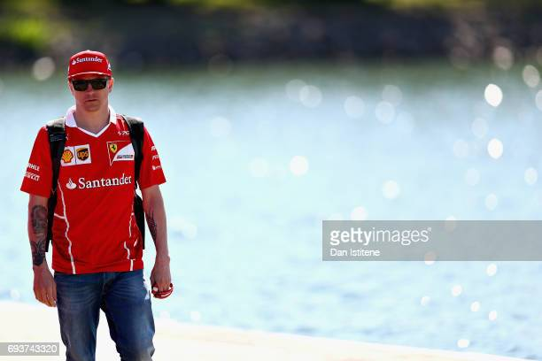 Kimi Raikkonen of Finland and Ferrari walks into the paddock during previews for the Canadian Formula One Grand Prix at Circuit Gilles Villeneuve on...