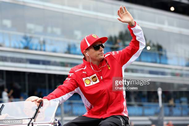 Kimi Raikkonen of Finland and Ferrari waves to the crowd on the drivers parade before the Formula One Grand Prix of Italy at Autodromo di Monza on...