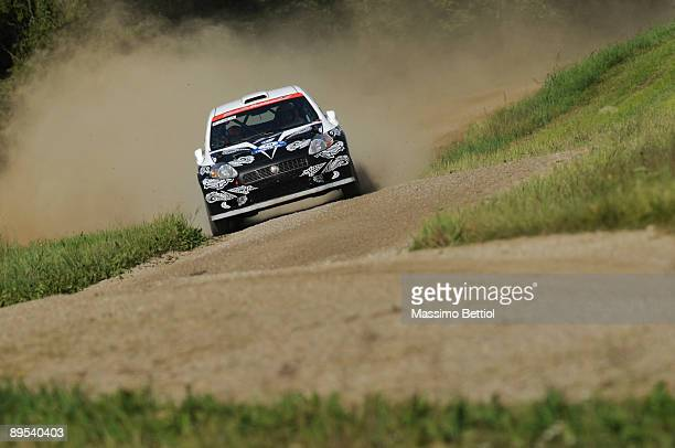 Kimi Raikkonen of Finland and Kaj Lindstrom of Finland compete in their Fiat Grande Punto S2000 during the Leg 1 of the WRC Neste Oil Rally of...