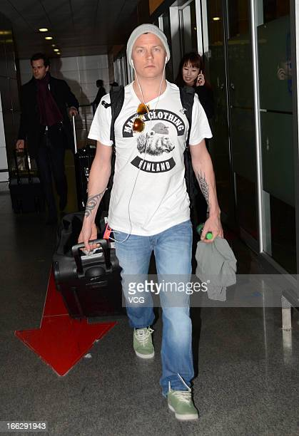 Kimi Raikkonen of Finland and Lotus arrives at Shanghai Pudong International Airport ahead of the Chinese F1 Grand Prix 2013 on April 11 2013 in...