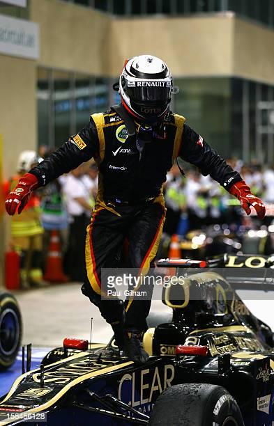 Kimi Raikkonen of Finland and Lotus celebrates in parc ferme after winning the Abu Dhabi Formula One Grand Prix at the Yas Marina Circuit on November...