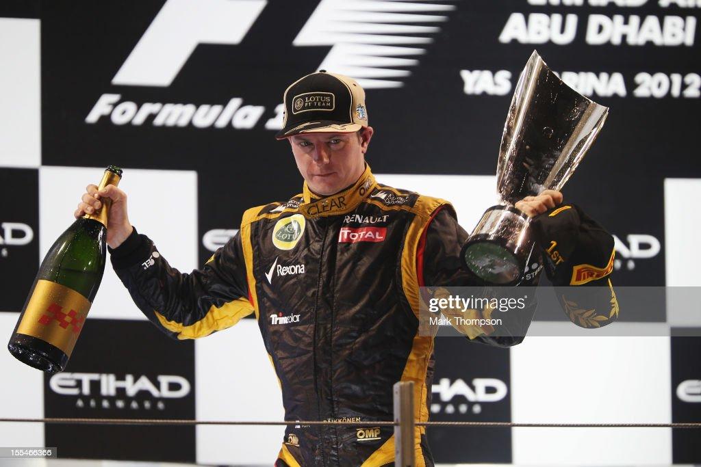 Kimi Raikkonen of Finland and Lotus celebrates on the podium after winning the Abu Dhabi Formula One Grand Prix at the Yas Marina Circuit on November 4, 2012 in Abu Dhabi, United Arab Emirates.