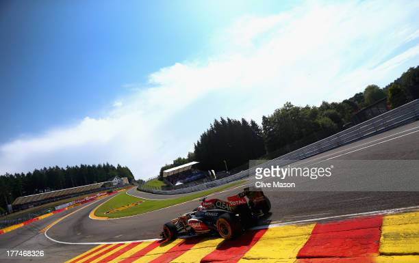 Kimi Raikkonen of Finland and Lotus drives thru Eau Rouge during practice for the Belgian Grand Prix at Circuit de SpaFrancorchamps on August 23 2013...