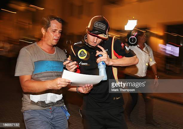 Kimi Raikkonen of Finland and Lotus leaves the paddock following practice for the Abu Dhabi Formula One Grand Prix at the Yas Marina Circuit on...