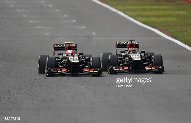Kimi Raikkonen of Finland and Lotus overtakes Romain Grosjean of France and Lotus during the Korean Formula One Grand Prix at Korea International...
