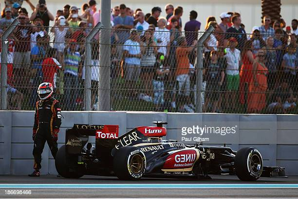Kimi Raikkonen of Finland and Lotus retires from the race on lap one of the Abu Dhabi Formula One Grand Prix at the Yas Marina Circuit on November 3,...