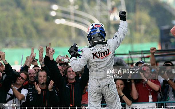 Kimi Raikkonen of Finland and McLaren celebrates after victory in the Japan F1 Grand Prix at the Suzuka Circuit on October 9, 2005 in Suzuka, Japan.
