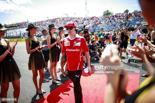 Kimi Raikkonen of Finland andScuderia Ferrari on the drivers parade before the Formula One Grand Prix of Hungary at Hungaroring on July 30 2017 in...