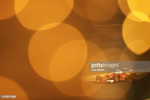 Kimi Raikkonen of Finland drives the Scuderia Ferrari SF16-H Ferrari 059/5 turbo on track during practice for the Bahrain Formula One Grand Prix at...