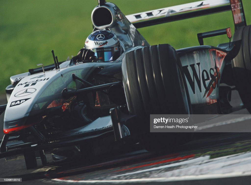Kimi Raikkonen of Finland drives the #4 West McLaren Mercedes McLaren MP4-17 Mercedes V10 during the Formula One Italian Grand Prix on 15 September 2002 at the Autodromo Nazionale Monza, Monza, Italy.