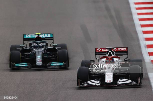 Kimi Raikkonen of Finland driving the Alfa Romeo Racing C41 Ferrari leads Valtteri Bottas of Finland driving the Mercedes AMG Petronas F1 Team...