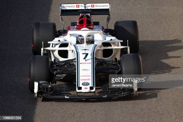 Kimi Raikkonen of Finland driving the Alfa Romeo Sauber F1 Team C37 Ferrari during day one of F1 End of Season Testing at Yas Marina Circuit on...